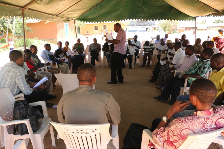 Mr. Kenneth Simbaya-standing-Facilitator briefing men's group .png