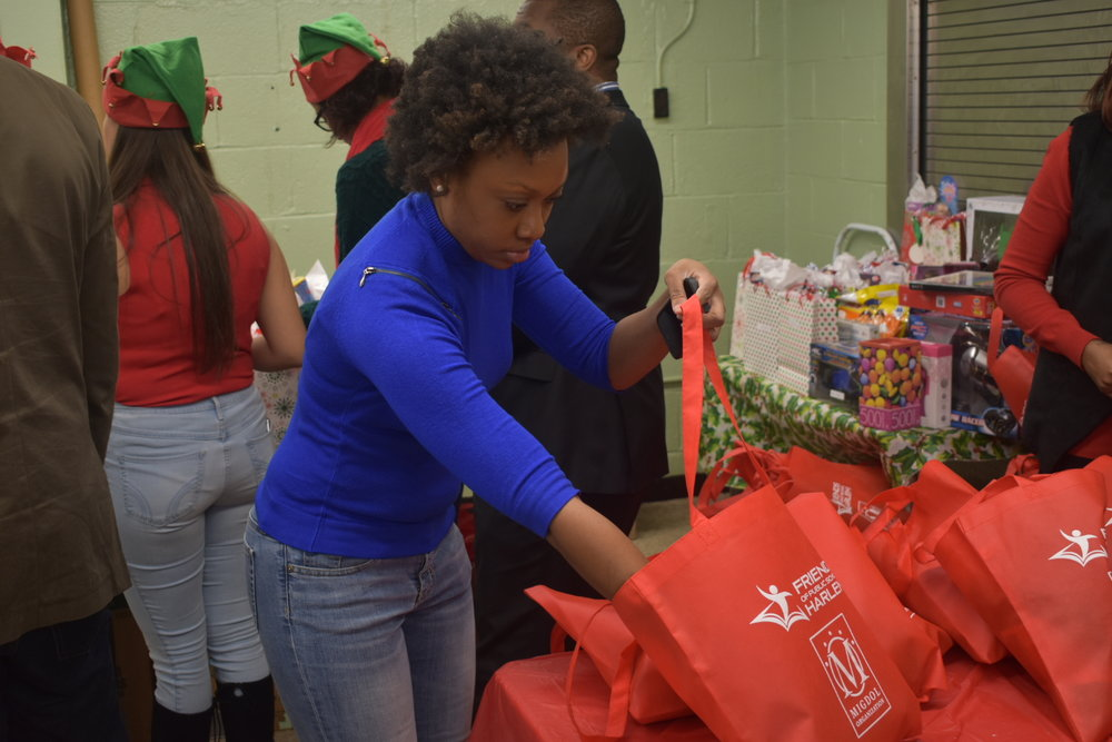 Shana Harmongoff packing gifts.JPG