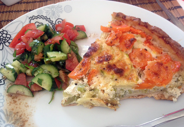 Quiche topped with carrots