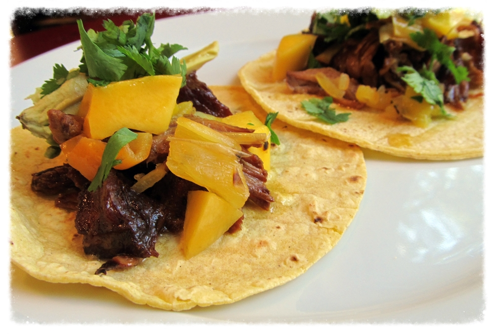 Pork carnitas cooked in pepper jelly for 8-10 hours--crispy, tender, sweet and a little spicy.