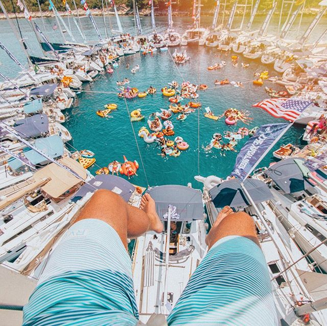 Throw back to one of my favorite experiences ever as a photographer #theyachtweek . I was in a harness and hoisted to the top of the mast as a group of 20+ yachts got together for a circle raft party.