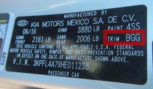Kia vehicles keep an interior trim sticker on the driver's side door pillar.