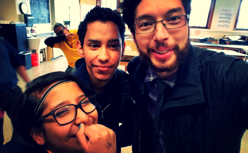 Anahi, Edgar, and me (with some successful photobombs in the background)--the traveling HackSchool Leadership Team!