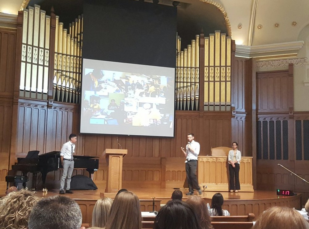 The HackSchool competition team presenting on the big stage during the final round of The Mind Trust's School Redesign Competition. Edgar (student, Junior) and Anahi (student, Freshman) did an incredible job! Photo cred:  Ben Jackson .
