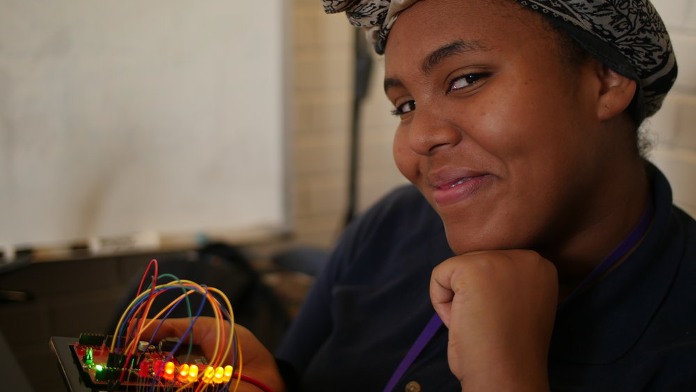 HackSchool Leader Shukri cheesin' it up with her Arduino controlled LED array!