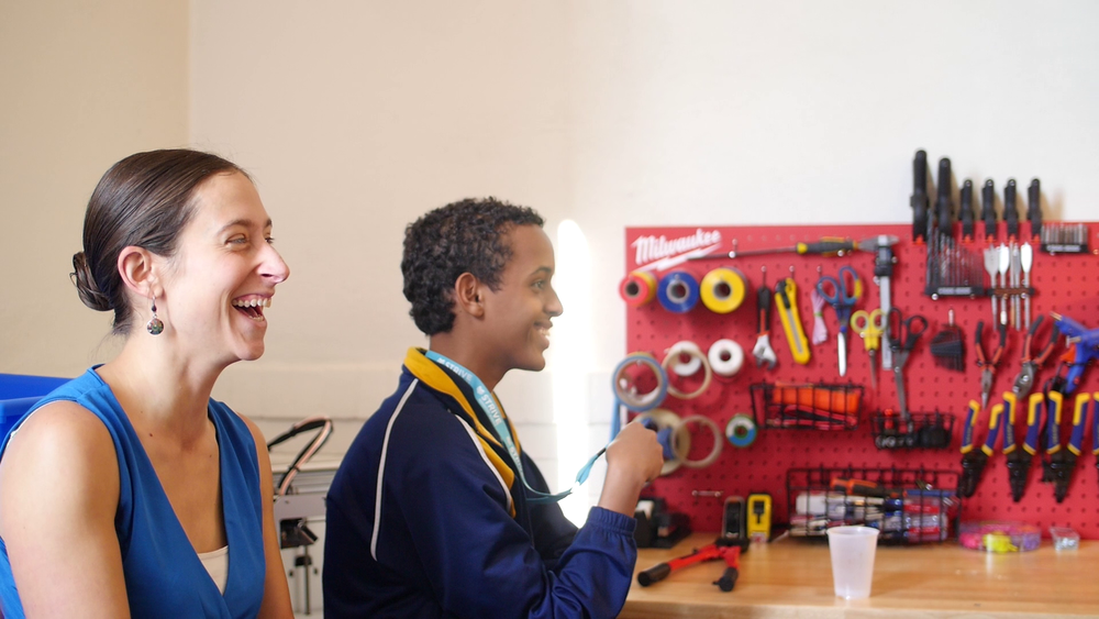 Believe it or not, solving real community problems is not only difficult and inspiring, it's also a ton of fun! Turns out one of Angelica's ideas was sparked by a mishap with a pinball machine... Pictured: our community guest, Ms. Ross, and Khaled.
