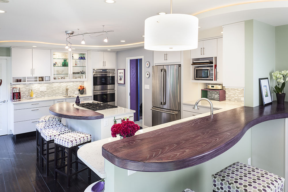 This kitchen includes purple cerused ash wooden countertops. | Designed and built by Forward Design Build