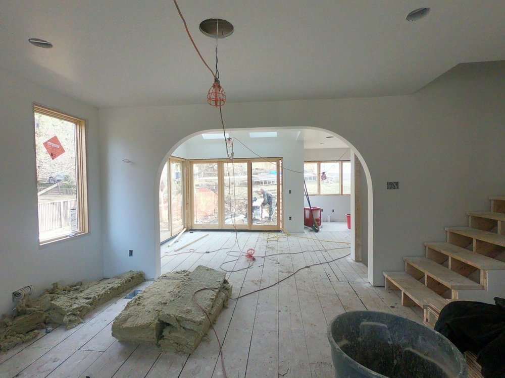 New stairs and arched entry into dining room