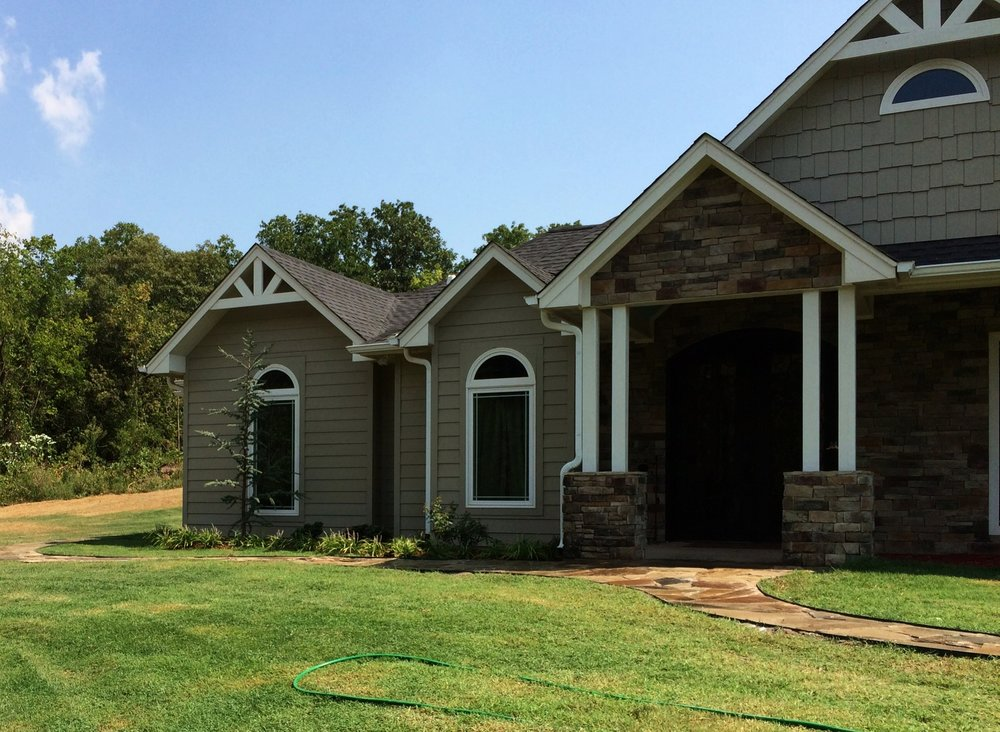 New beds, sprinklers, and walkway for new home near Glencoe