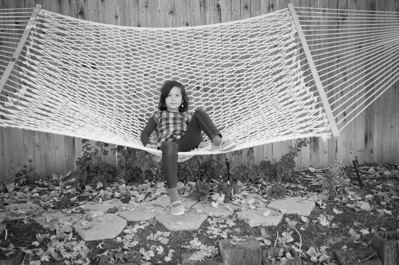 twopaperhorses :     Isabelle kickin' it in the hammock. | Mom's backyard     Sweet little Isabelle.