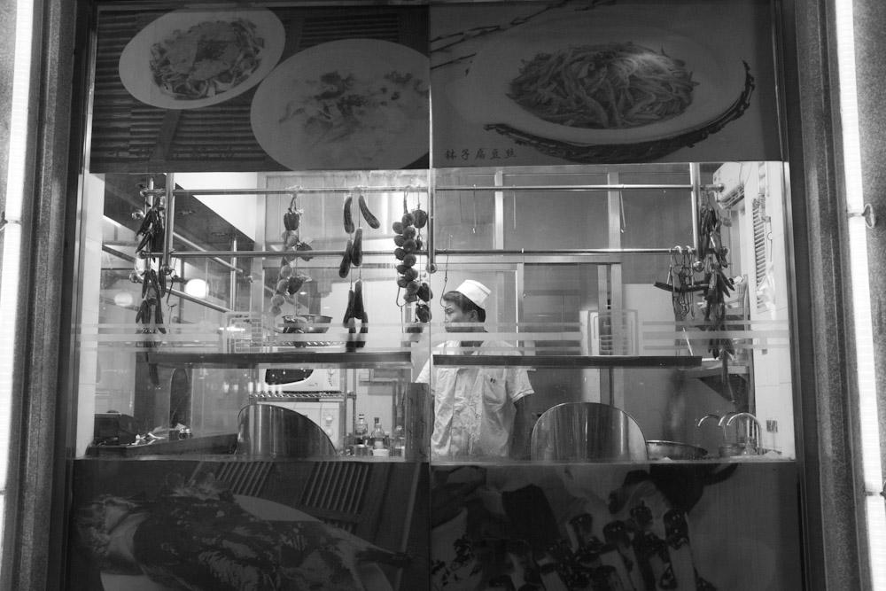 Night scene inside a Chinese restaurant.   Beijing, China.