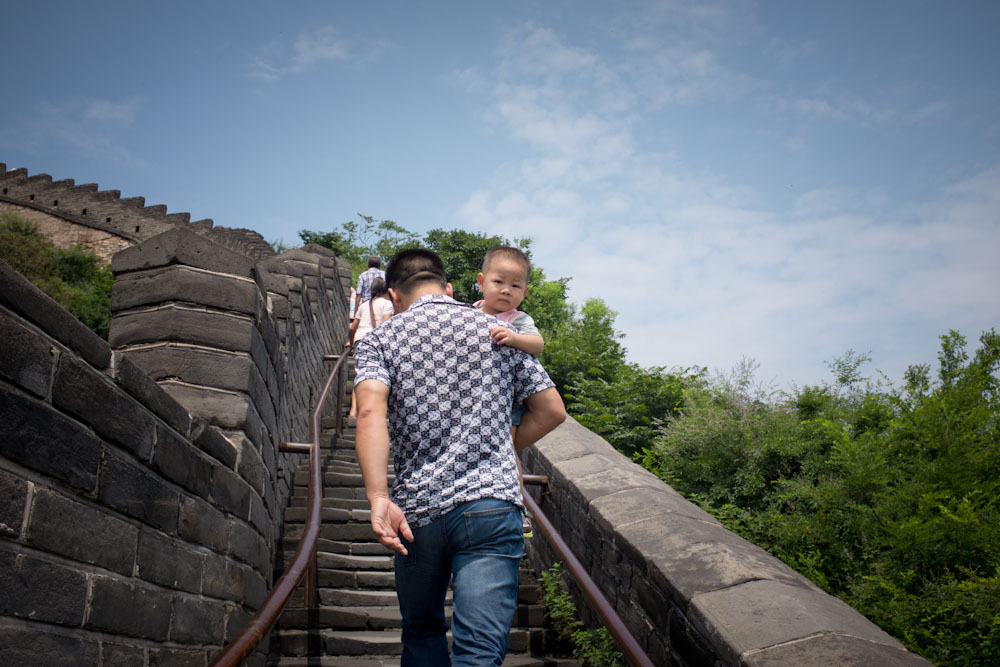 Family hike up the Great Wall of China.