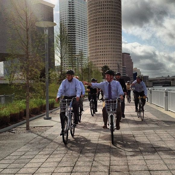Former DOT Secretary Ray LaHood and Tampa Mayor Bob Buckhorn biking on the Tampa Riverwalk