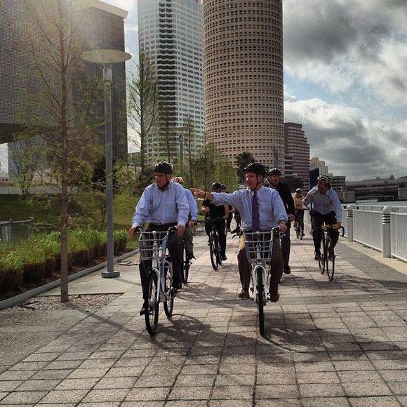 Former DOT Secretary Ray LaHood and Tampa Mayor Bob Buckhorn biking on the Tampa Riverwalk
