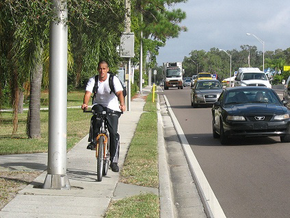 bicyclists riding on narrow sidewalk adjacent to US 41