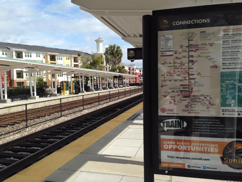 Lake Mary's SunRail station platform with the Station House development in the background.