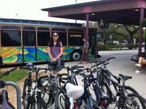 woman with bikes and bus