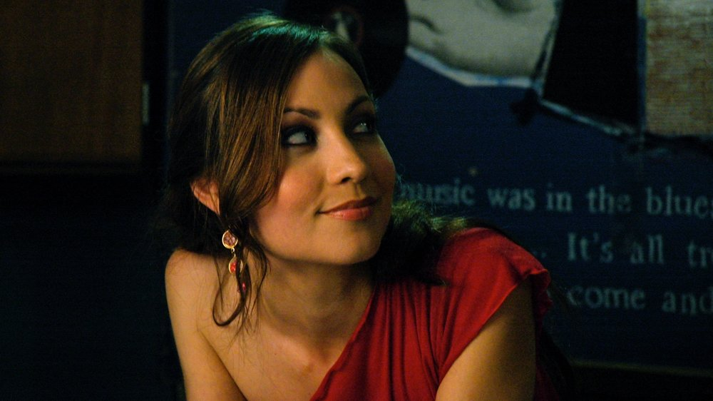 "Courtney Ford as ""Sam"""