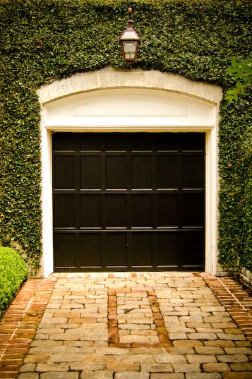 It's amazing how just a simple black garage door and some vines can have such an impact.