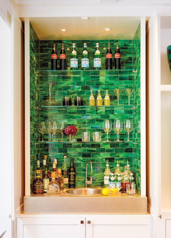 malachite tiles accent the different bottles and colors