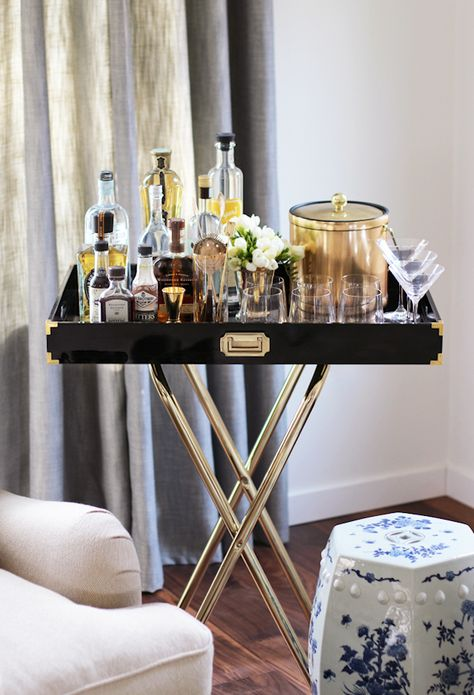 it's a mini campaign tray table bar!  love