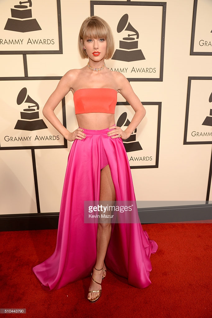 Taylor Swift in a bandeau top and full hot pick skirt.  She's also looking a bit like anna Wintour with her shorter bob