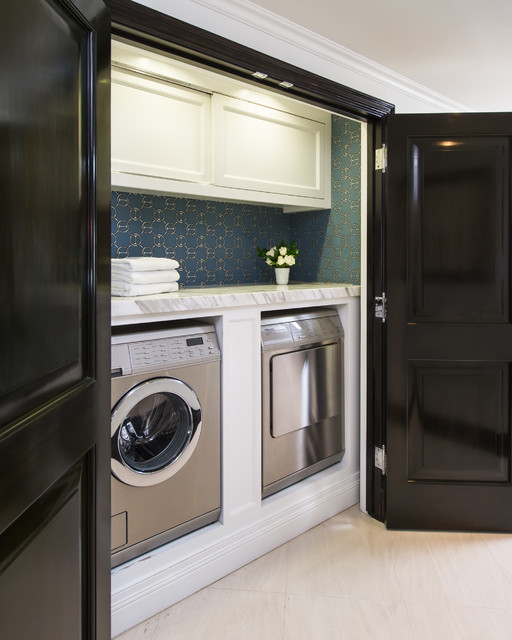 hello glossy black doors and stainless appliances!  design by  m wright design