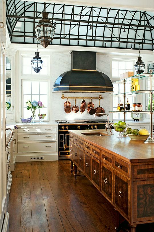 Could this  kitchen  have any more character?!!!  between the greenhouse ceiling, the hood that mimics the shape of the ceiling and The shelves that are asking for some sweet treats to grace its perch