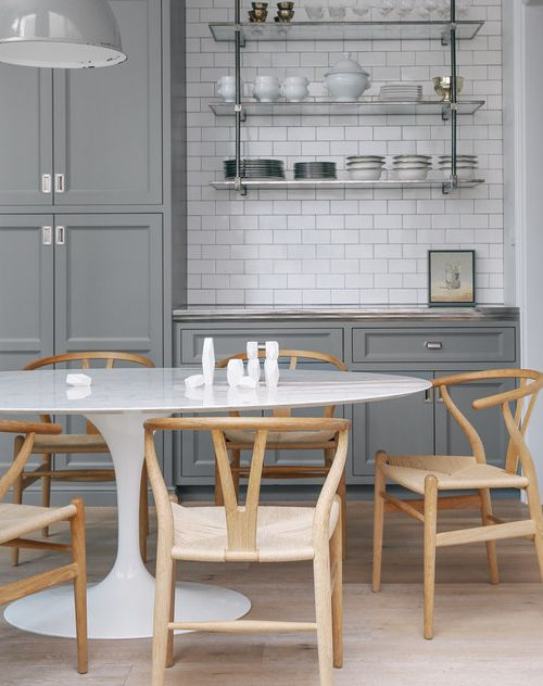 i clearly love this kitchen a lot because i recently featured it for the  metal shelves .  but also take note of the  wishbone chairs , they are becoming quite popular