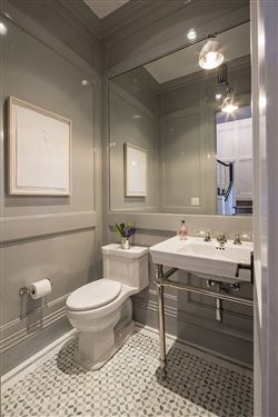 a simple, serene  powder room