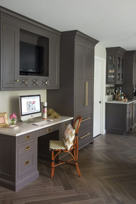 i love everything about this kitchen space.  the cabinet color with the brass hardware, the small drawers with an architectural feature, and the tv!  And if the witching hour gets to be too much you're just a few steps away from the bar
