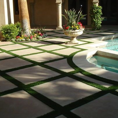By having larger pavers, it gives the feeling of a larger space.