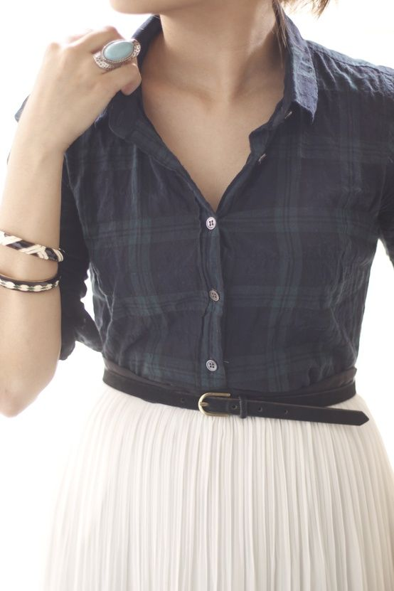 A perfect way to wear a pleated skirt in the Fall paired with a plaid shirt.