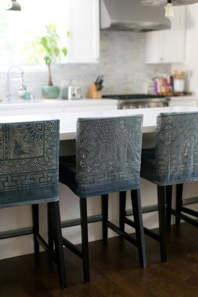 I'm kinda dying over  these  denim slipcovered barstools with a stencil pattern over them.  So unique and one of a kind