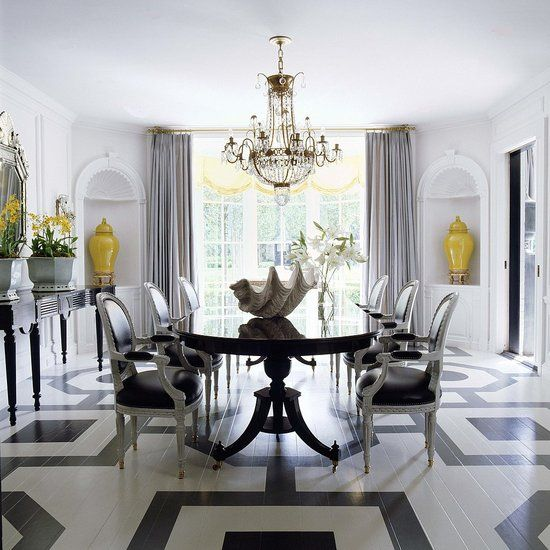 A smashing neutral dining room that pops with the yellow accents and white floor designed by  Mary McDonald .