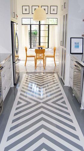 I don't know if this is epoxy or what, but sign me up for high gloss floors! And note how the pattern is also brought into the eat in kitchen under the table.