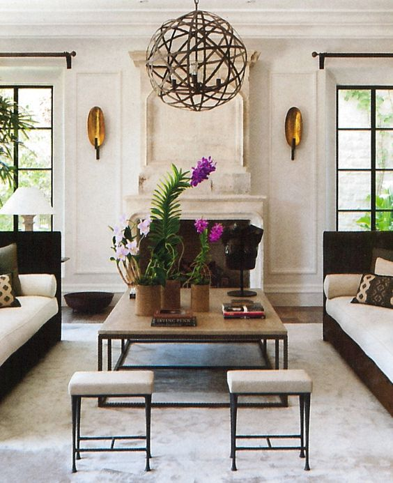 Lusting over those sconces. Via  Architectural Digest