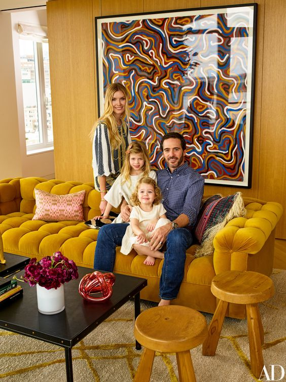 How precious are their daughters, Evie and Lydia.  I also can't get over that mustard velvet vintage edward Wormly sofa.