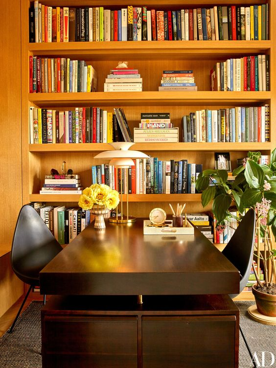 i love a vacation home that has lots of books.  it's practical, yet also reminds you to stop and relax, and maybe read a book, or flip through the pictures of a photography book