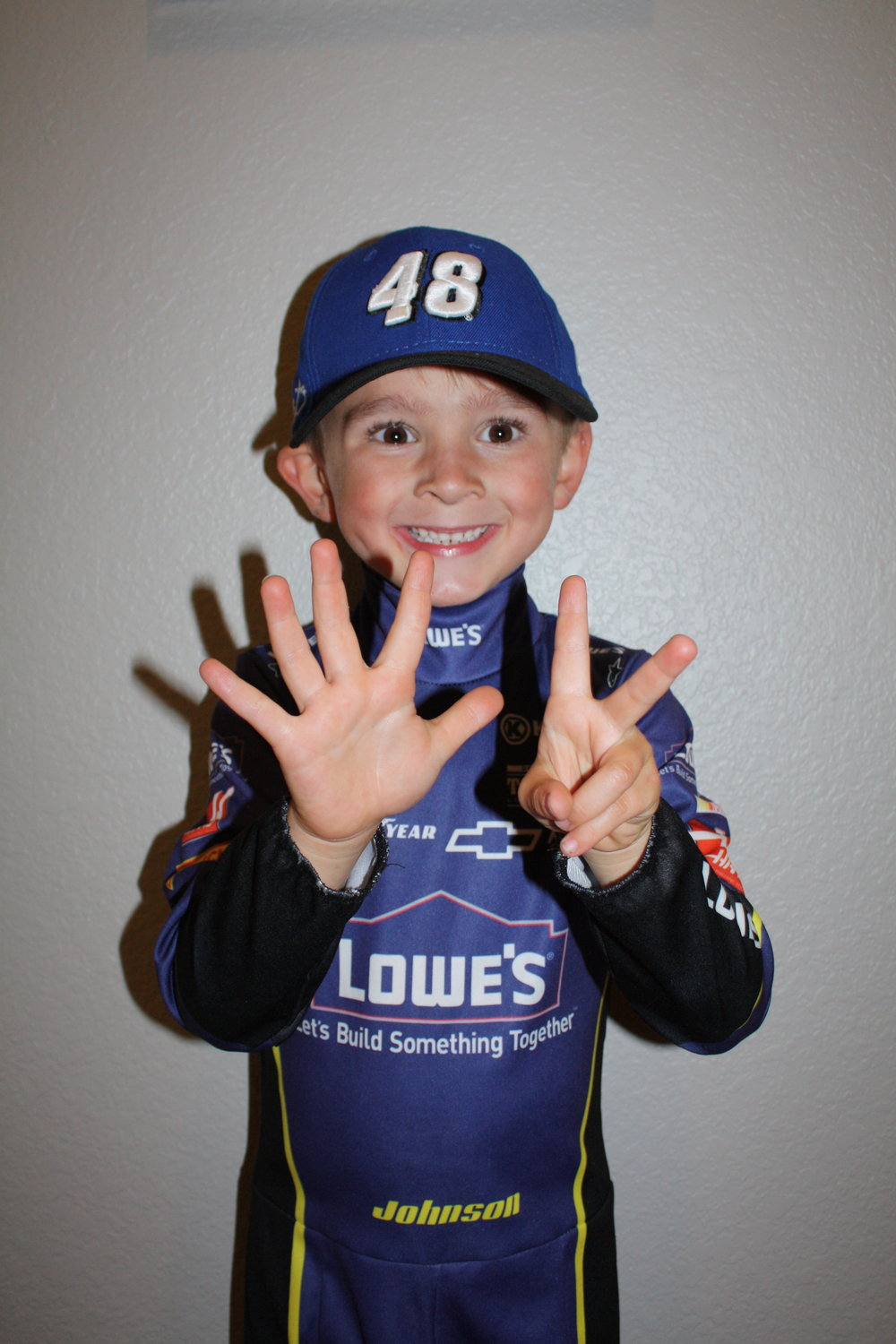 Our little Asher as Jimmie for Halloween, wishing for his 7th championship