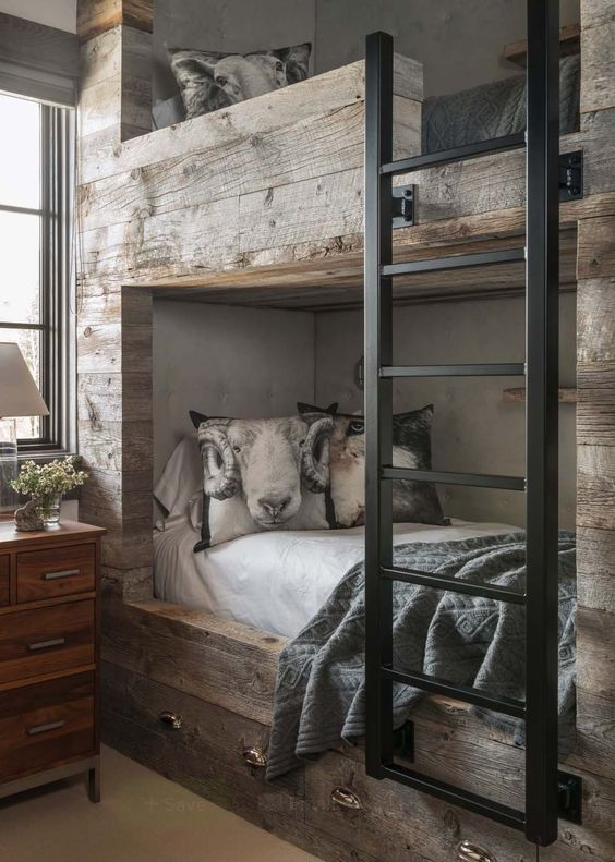 Oh my!  All I can look at is that ram looking back at me.  But this one photo is a perfect example of mixing materials.  Two different colors of wood (in the bunk beds and nightstands), mixing metals (drawer hardware and ladder) and having a bit of white to pop.