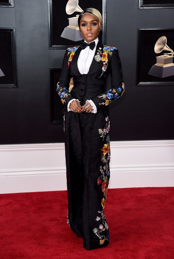 Janelle Monae wearing dolce & Gabbana.  This look stopped me in my tracks.  it's a practice in restraint when it comes to both fashion and design.  How much can you push it without it being too much.  there's a definite fine line for sure.  This is a perfect example.  sure there is a lot going on in this outfit.  but if say the white ruffle sleeve wasn't there, I think you would feel the black needed to be broken up a bit.  She has a lot of rings but they are all for the most part simple, not blingy which had they been, would have been too much.