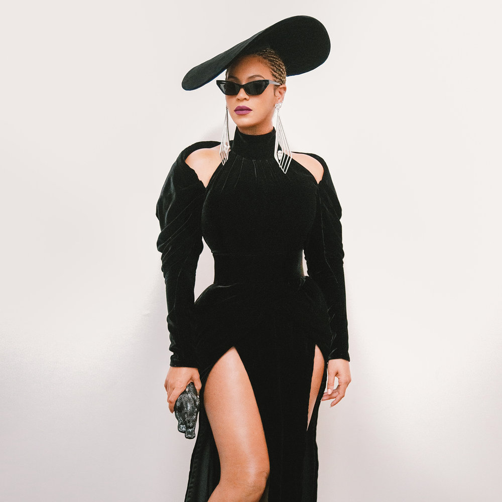 beyonce wearing a velvet Jebran gown and an oversized fascinator also by the designer.  She accessorized the look with Lorraine Schwartz jewels and cat eye shades by Alain Mikli.