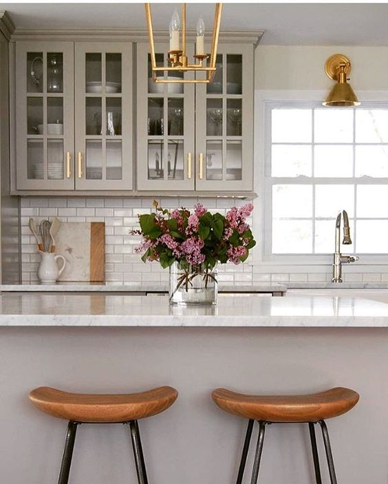 Oh those stools and brass bring so much warmth to this space.