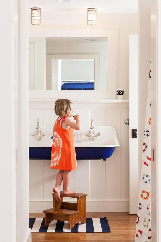 I can't handle how cute kids look just standing at this sink!