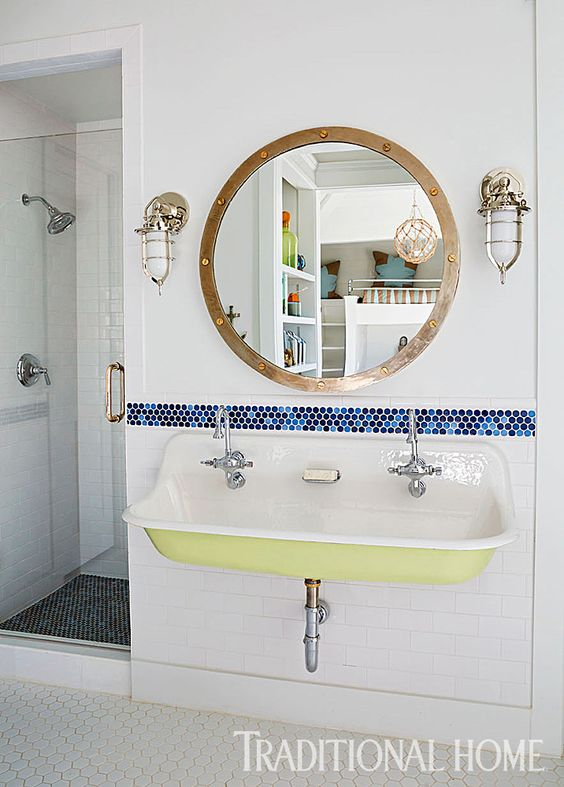 A simple nautical bathroom with a pale avocado paint color for the underside of the sink.  via  Traditional Home