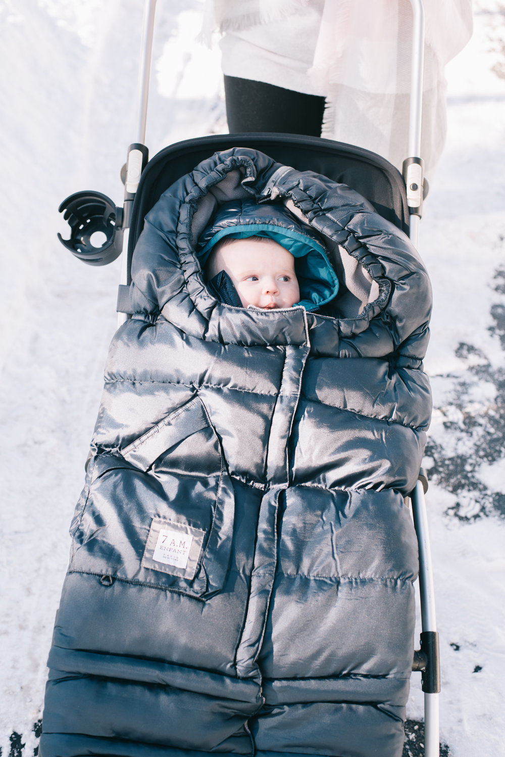 The Wind And Water Repellent Car Seat Cocoon Slips Simply Over To Keep Baby Warm While Traveling Omitting