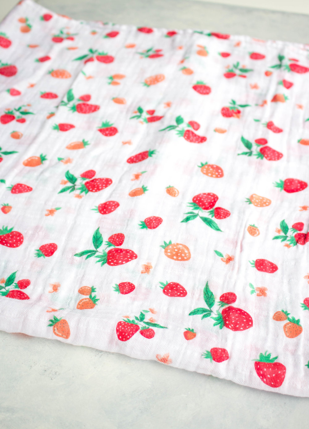Lay your swaddle blanket down flat. I folded this into a square, as they are rather large!