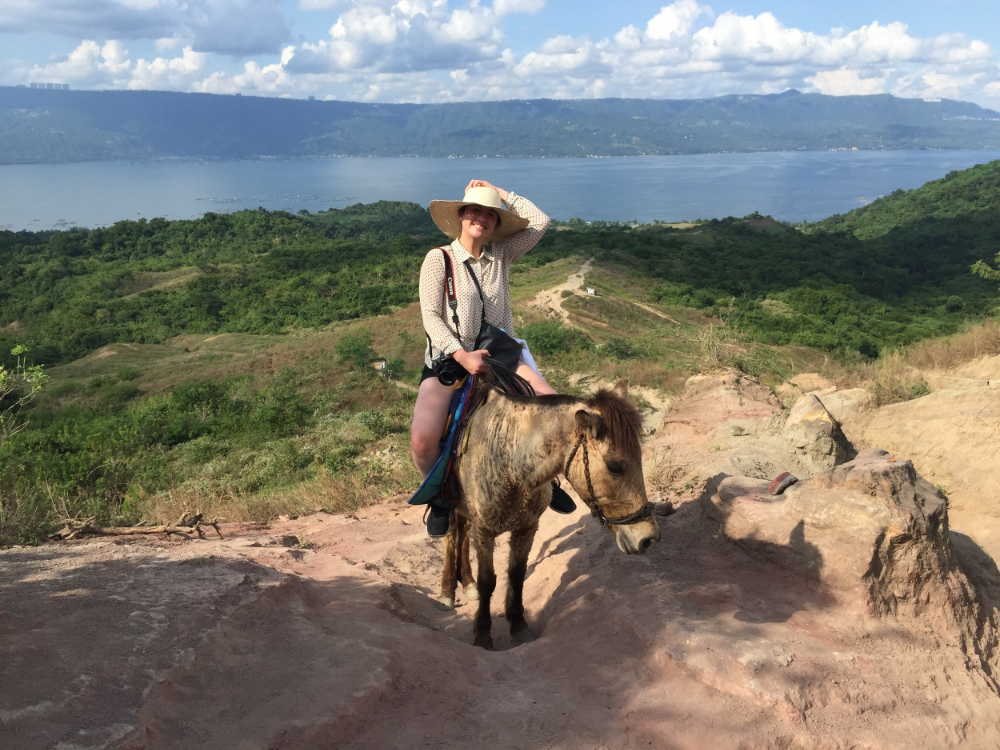 Climbing Taal Volcano. That is,  riding  a tiny horse that's climbing the volcano.
