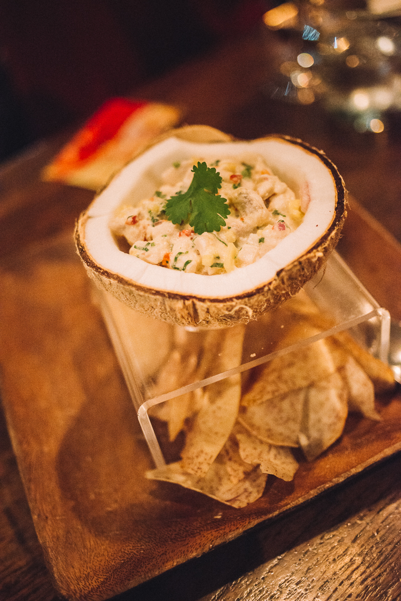 COCONUT CURRY CEVICHE | local white fish, green curry, chilies, taro chips